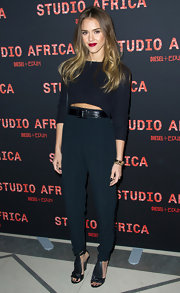 Jessica Alba showed her edgier side at the Studio Africa party in Paris with a belted high-waisted pants and a crop top.