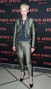 Tilda Swinton has never been one to shy away from funky designs. The star showed her unique taste again with a patterned pantsuit, which she wore to the Studio Africa party in Paris.