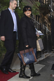 Kris Jenner traveled about NYC in style with a fashionable leather tote. The brown and navy blue tote was the perfect complement to her ensemble.