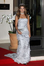 Princess Madeleine exited the Hermitage Hotel in a gorgeously ruched silver gown.