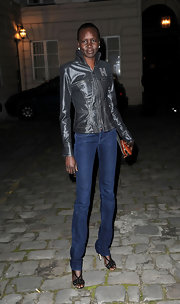 Alek Wek kept her look simple with black strappy sandals.