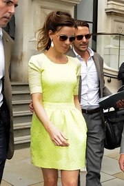 Kate looked vibrant in this chartreuse day dress while in transit to her premiere.