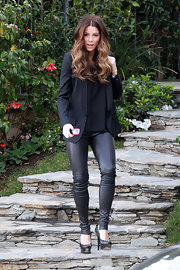 Kate Beckinsale contrasted her tight leather pants with a tailored blazer.