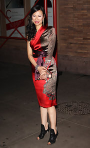 Wendi Deng arrived at Glamour Magazine's event wearing a one-shoulder dress and a pair of glam cutout ankle boots.