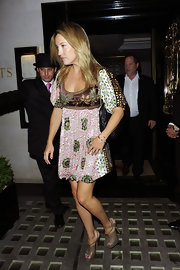 Kate Hudson was spotted in a printed tunic dress with gray platform sandals.