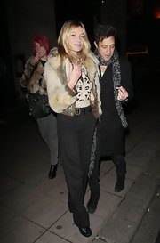 Kate Moss paired her fur coat with loose black slacks.