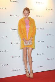 Olivia Inge was adorable on the red carpet in a pink chiffon dress teamed with a yellow fur coat.