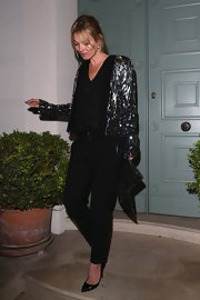 Kate Moss stepped out in this gunmetal sequined blazer for a fun and glam look while out in London.