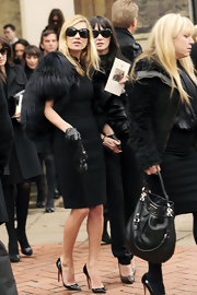 "While attending the funeral of famous designer Alexander McQueen, Kate Moss wore a sky high pair of patent leather ""Pigalle"" pumps that were fitting for the tragic occasion."