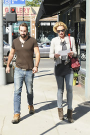 Katherine Heigl was on trend for fall with olive green suede ankle boots.