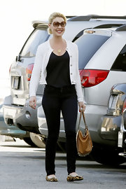 Katherine Heigl opted for comfy footwear, wearing animal print flats.