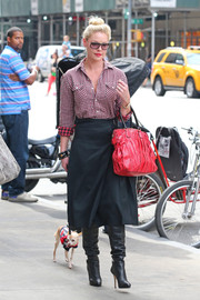 Katherine Heigl showed off her chic street style with this checkered button-down, A-line skirt, and slouchy boots combo while out and about in New York City.