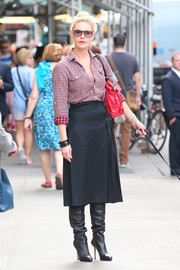Katherine Heigl smartly paired a gray A-line skirt with a checkered button-down for a day out in New York City.