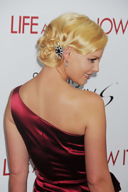 Katherine looked stunning with her hair pinned up in an elegant updo.