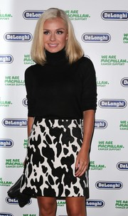 Katherine Jenkins went to the Macmillan De'Longhi art auction looking stylish in a black turtleneck and a print mini skirt.
