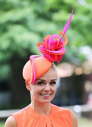 Katherine Jenkins sported an elegant orange and pink intricate swirl topper at the Royal Ascot's Opening Day.