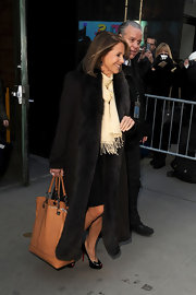 Katie Couric bundled up in style with an ankle-length wool coat with fur trim.