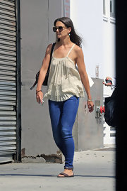Katie balanced out her flowing top with blue skinny jeans.