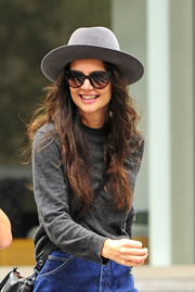 Katie Holmes didn't seem to mind looking deglammed in a gray crewneck sweater and a denim skirt as she spent a day out with her friend.