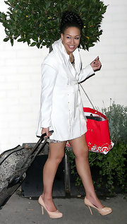Rebecca Ferguson left the Fountain Studios looking super stylish in a white shawl-collar jacket.