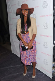 Tika Sumpter paired a black envelope clutch with her outfit for the opening of Rebecca Taylor's flagship store.