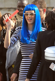 Katy Perry loves to experiment with her hair color. At a fashion show in Paris, Perry opted for a vibrant blue wig styled straight with blunt cut bangs.