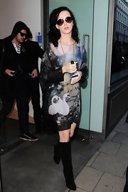 Katy Perr left the Dover Street Market in sleek black suede knee high boots.