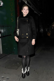 Rosamund Pike kept warm in black leather peep toe booties lined in sheepskin.