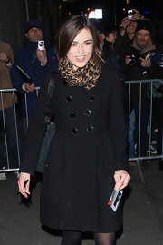 Keira Knightley left London's comedy Theatre wrapped in a leopard print scarf.