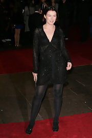 Olivia paired her tights with a sequined cocktail dress that simply sparkled.
