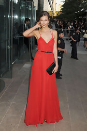 Karlie Kloss matched the elegant feel of her 2011 CFDA Awards look with a black satin envelope clutch.