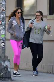 Kelly Bensimon opted for fuchsia workout leggings that showed her support of Soul Cycle.