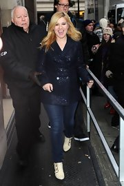 Kelly was all smiles in this sparkly navy pea coat on her way to the BBC Studios in London.