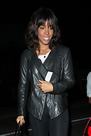 Kelly looked sleek in a black leather jacket while out in Hollywood with Serena Williams.