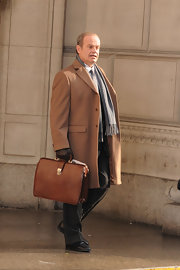Kelsey Grammer completed his business-like attire with a tan leather briefcase while filming in Manhattan.