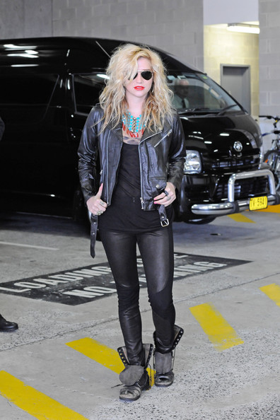 Ke$ha looking every bit the rockstar with her leather jacket and untied combat boots, as she leaves Nova Radio Station in Sydney, Australia