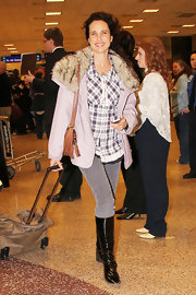 Andie MacDowell topped off her plaid shirt with black patent leather flat boots.