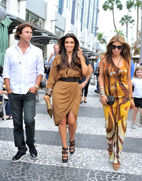 colored dress, today with by friends Jonathan Cheban and Larsa Pippen