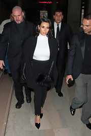 Kim Kardashian's furry black clutch could double as a throw pillow.