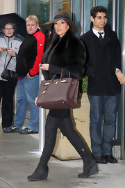 Kim showed off one of her newly purchased Birkin bags while hitting NYC while filming the hit show, 'Keeping Up With the Kardashians'.