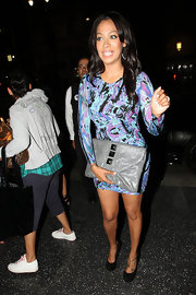 La La paired her printed dress with leather studded clutch.