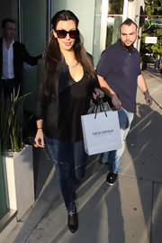 Kim pulled her famous long brown locks back into a half up hairstyle for a day of shopping.