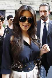 Kim showed off her classy side in a chic pair of aviator shades.