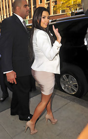 Kim Kardashian waved to paparazzi wearing a pair of Cesare Paciotti 560410 pumps. The flesh toned pumps elongate Kim's legs and we love the unique details on the heels and platforms of the shoes.