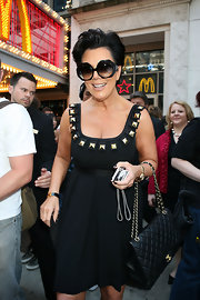 Kris Jenner came out to support her daughter Kim for the unvieling of her wax figure. Kris sported a black day dress and a classic quilted handbag.