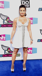 Demi Lovato struck a pose at the 'VH1' Do Something Awards in white platform peep-toes with contrasting black tips. The heels matched her sexy white halter dress.