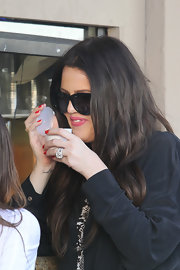 Khloe stuck with the klassics, er, classics and painted her nails a lovely shade of cherry.