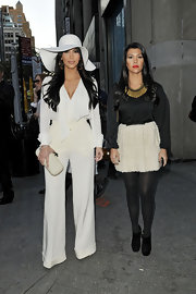 Kim Kardashian topped off her sophisticated style with a white floppy hat while out with Kourtney in NYC.