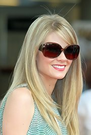 Kim Matula wore a chic pair of sunglasses to match her equally chic dress at the Monte Carlo TV Fest.