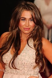 Lauren Goodger showed off her varied highlights with long spiral curls.